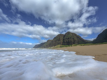 Surf Running Up The Sandy Beach Pushes Foam In Different Shapes, Polihale Beach State Park, Kauai, Hawaii