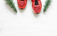 Christmas Sport Shoes Flat Lay Composition With Sneakers, Christmas Tree On Grunge White Wood  Background. Merry Christmas And Happy New Year Background Special For Healthy Lifestyle And Sport.