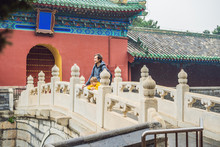 Dad And Son Travelers In The Temple Of Heaven In Beijing. One Of The Main Attractions Of Beijing. Traveling With Family And Kids In China Concept