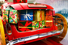 2019 Christmas And New Year Concepts,An Opened Red Car Trunk Filled With Cloth Bags Full Of Gifts And Decorations For Christmas