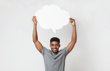 African-american Man Holding Blank Speech Bubble On White