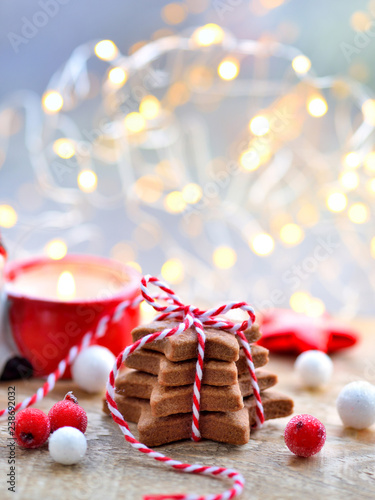 Christmas cookies with christmas decorations on blurred and sparkling background. Christmas or New Year greeting card.