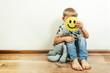 Leinwandbild Motiv Depressed boy holding smile, pretending to be fine. Face of the depression