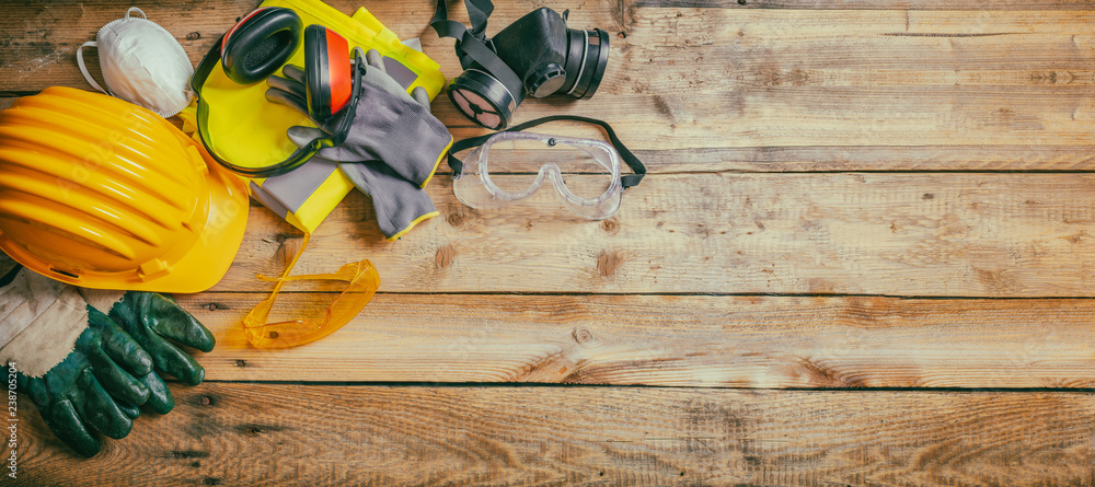 Fototapety, obrazy: Construction safety. Protective hard hat, headphones, gloves and glasses on wooden background, banner