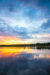 Scenic sunset on the river. Colorful reflection in the water
