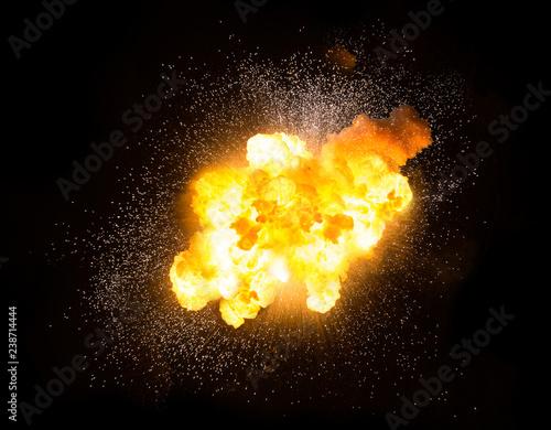Obraz na plátně Realistic fiery explosion with sparks over a black background
