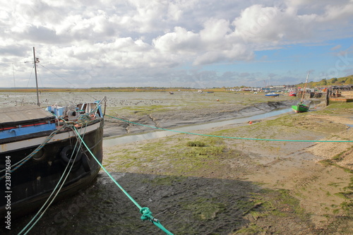The muddy beach at low tide with moored fishing boats along the Thames Estuary, Wallpaper Mural