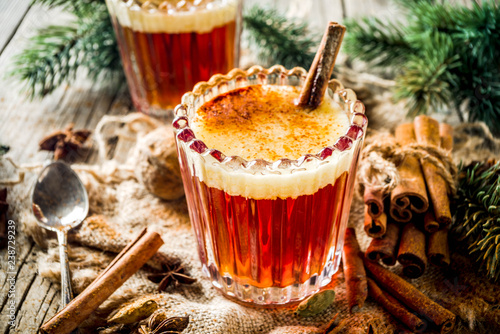 Obraz na plátně Winter holidays traditional drink, homemade hot buttered rum with spices, over o
