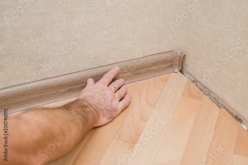 Canvas Print Technology of installation and installation of plastic floor plinth - Worker mou