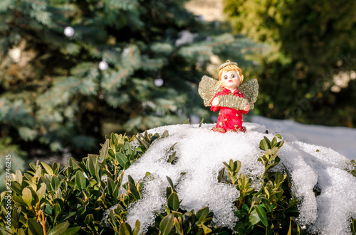 Poster Feeën en elfen Winter angel figure red new year in the snow on the Christmas tree concept
