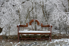Old Wooden Bench In A Snow-cov...