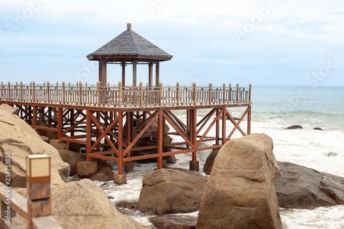 Fotografia  Wooden stairs along the sea coast