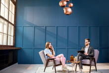 Woman Client Sitting With Male Psychologist On The Chairs During The Psychological Session At The Blue Office Interior. Image With Copy Space