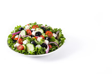 Fresh Greek Salad In Plate With Black Olive,tomato,feta Cheese, Cucumber And Onion Isolated On White Background. Copyspace
