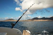 Fishing Rod Over Blue Sea
