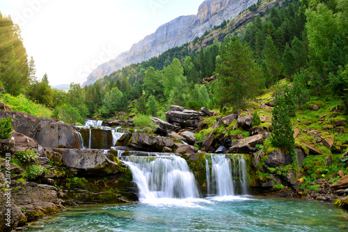 Photo Stands Waterfalls Waterfall in Ordesa and Monte Perdido National Park. Pyrenees mountain. Province of Huesca, Spain.