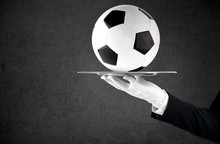Waiter That Holds A Tray With Soccer Ball. Concept Of First Class Service On Soccer