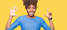 Beautiful Young African American Woman Over Isolated Background Showing And Pointing Up With Fingers Number Seven While Smiling Confident And Happy.