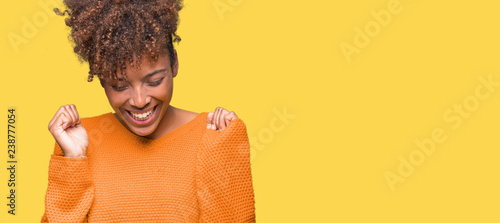 Fotografia  Beautiful young african american woman over isolated background celebrating mad and crazy for success with arms raised and closed eyes screaming excited