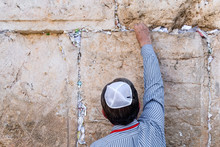 Jerusalem Israel, Leave The Letter With A Prayer. Tourist Jew Puts A Letter With A Request To God In The Gap In The Wailing Wall