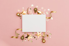 Flat Lay Party Decoration Concept On Pastel Pink Background With Blank White Card