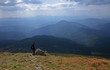 The stone peaks of the mountain ranges of Hoverla Ukrainian Carpathian mountains covered with ancient conifer forests