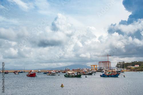 Fototapeta Stormy cumulonimbus in Arousa island fishing harbor obraz na płótnie