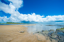 Bright Scenic View Of Rustic Deserted Brazilian Beach With The Low Tide Ocean Receding Over The Shallows Of Coral Reefs On The Empty Horizon In Bahia, Brazil