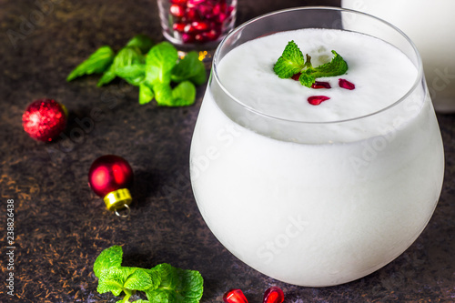 Poster Cocktail White Christmas cocktail coconut Mojito drink on festive background