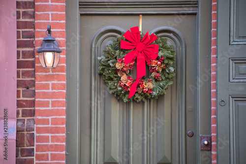 Large Christmas Wreath And Red Bow Grace The Ornamental Front Door Of Historic Home Buy This Stock Photo And Explore Similar Images At Adobe Stock Adobe Stock