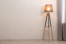 Modern Floor Lamp Against Bric...