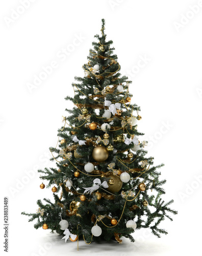Photo Christmas tree decorated with gold patchwork ornament artificial star hearts pre