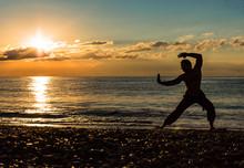 Man Practising Wushu At Sunset...