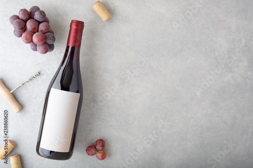 Bottle of red wine with label. Fototapeta