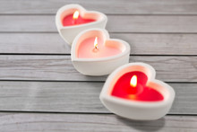 Valentines Day And Decoration Concept - Heart Shaped Candles Burning