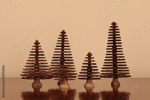 Fotografering  Decorazione natalizia. Abeti di legno intagliati a mano
