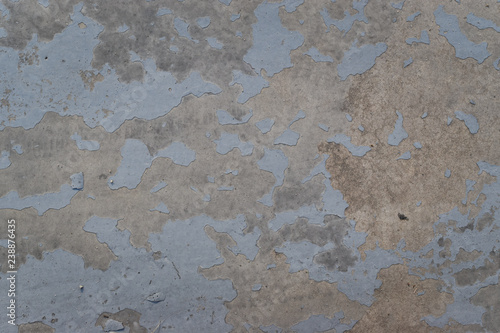 Photo sur Aluminium Vieux mur texturé sale Blue dirty peeled wall with falling off flakes. Old weathered painted wall background texture.