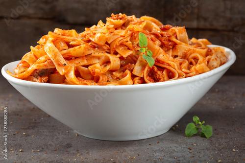 Tagliatelle pasta with tuna sauce and herbs Fototapeta