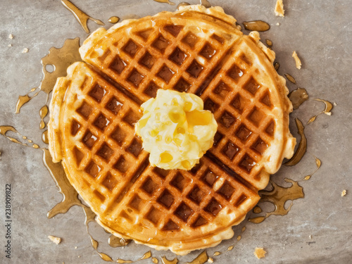 Fotografie, Obraz  rustic traditional waffle with butter and maple syrup