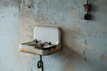 Old Rusted Sink With Broken Faucets And Light Switch In Alcatraz Prison
