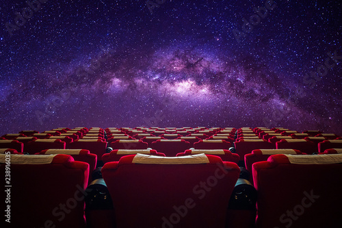 фотография Cinema hall with red seat in Milky way galaxy.