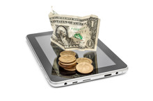 Coins With Crumpled One Dollar Bill On Tablet PC. Isolated On White.