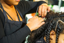 Close Up African Hairstylist Braided Hair Of Afro American Female Client In The Barber Salon. Black Healthy Hair Culture And Style. Stylish Therapy Professional Care Concept. Selective Focus.