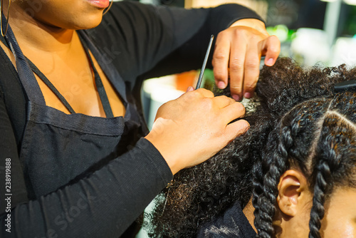 Close up african hairstylist braided hair of afro american female client in the barber salon Tapéta, Fotótapéta