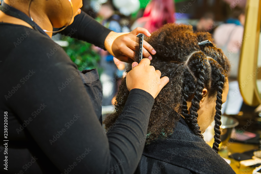 Fototapety, obrazy: Close up african hairstylist braided hair of afro american female client in the barber salon. Black healthy hair culture and Style. Stylish therapy professional care concept. Selective focus.