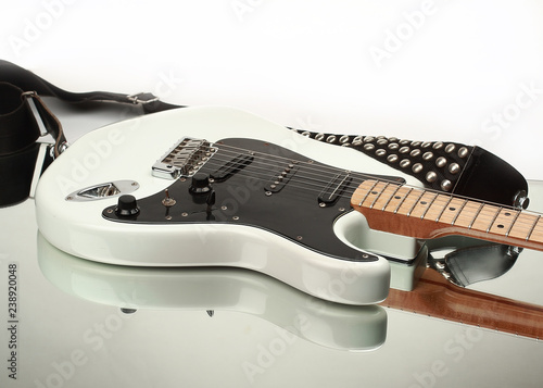 Fotografía  closeup.electric guitar with strap isolated on white background.