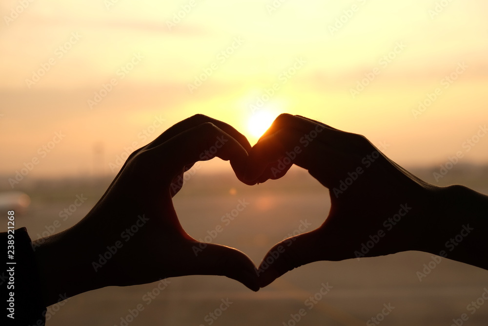 Fototapety, obrazy: Heart shape from two hand with sunrise background.