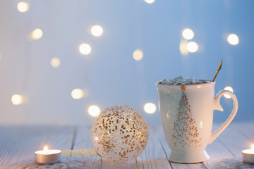 white cup with golden decor...