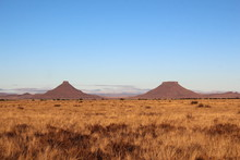 Two Well Known Flat Top Mountains In The Central Karoo Called Koffiebus And Teebus, South Africa.