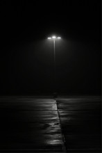 A Street Lamp On A Foggy Morni...